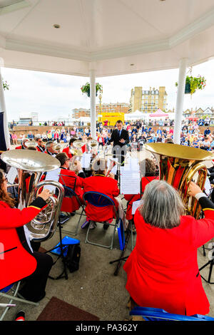 Salvation Army band performing on summer's day at the bandstand on Broadstairs seafront. Over the shoulder view from back of orchestra. - Stock Photo