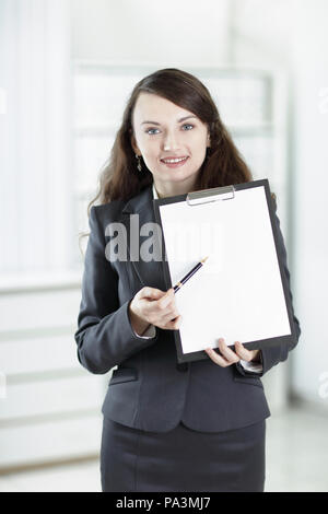 modern business woman pointing at blank sheet. - Stock Photo