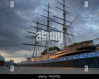 Summer cloudy evening golden light the Cutty Sark near the Old Naval College, Greenwich, UK - Stock Photo