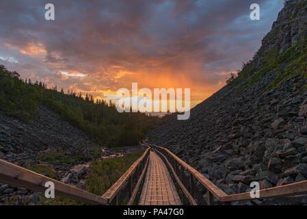 sunrise over a footbridge in fulufjallet national park dalarna Sweden - Stock Photo