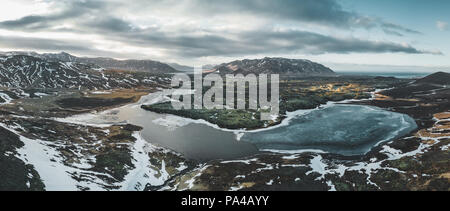 Aerial drone photo of a empty lake a huge volcanic mountain Snaefellsjokull in the distance, Reykjavik, Iceland. - Stock Photo
