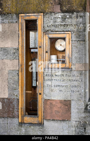 The Barometer, thermometer and barograph with time and geographic info on the wall of the Guildhall building in Winchester, Hampshire, England. - Stock Photo