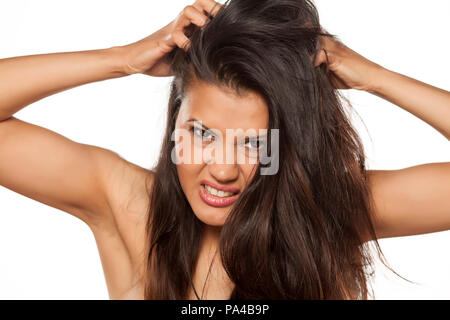 beautiful young latina has itching in her hair - Stock Photo