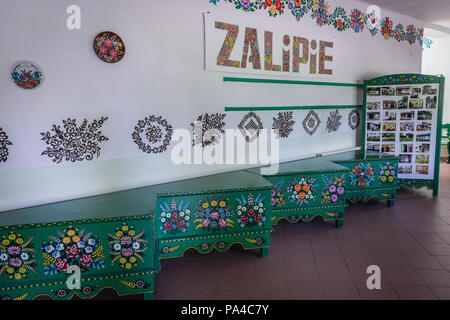 Interior of community centre called House of Painters in Zalipie village in Poland, known for its local tradition of floral paintings - Stock Photo