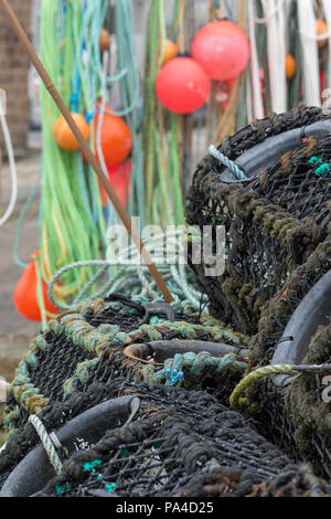 old fishing related paraphernalia rope pots and nets for lobsters and crabs at sennen cove in cornwall. - Stock Photo