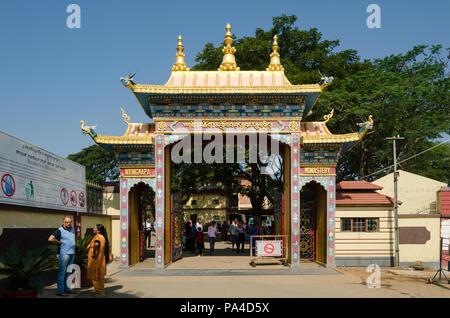 Entrance gate of the Namdroling Monastery in Mysore district, Karnataka, India - Stock Photo