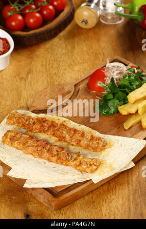 Chicken Adana kebap served with lavash - Stock Photo