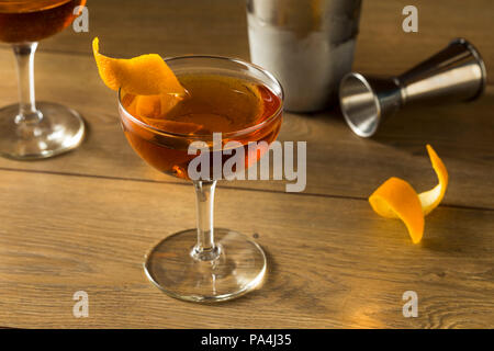 Alcoholic Martinez Cocktail with Gin Vermouth and Orange Peel - Stock Photo