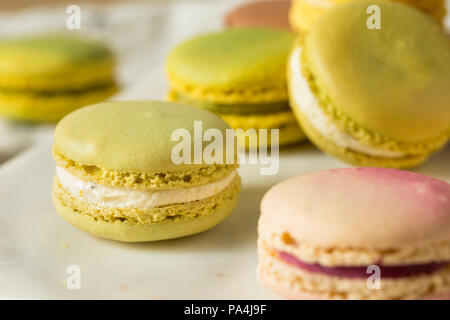 Colorful Homemade Sweet French Macarons Ready to Eat for Dessert - Stock Photo