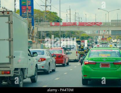 BANGKOK, THAILAND - MAY 9, 2018: Traffic moves slowly along a busy road in Bangkok, Thailand. - Stock Photo