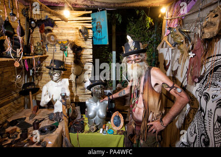 Old hippie at his stall, Las Dalias Market, Ibiza - Stock Photo