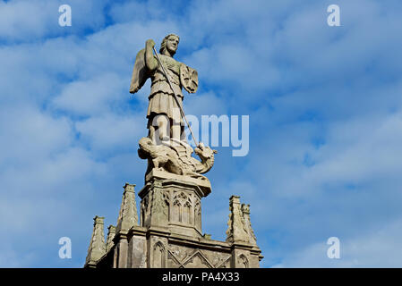 Statue of St George killing the dragon, Alnwick, Northumberland, England UK - Stock Photo