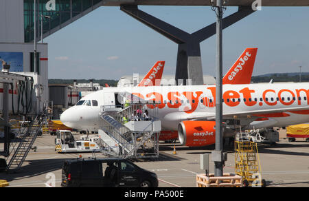people boarding an EasyJet plane on the apron at London Gatwick Airport, UK - Stock Photo