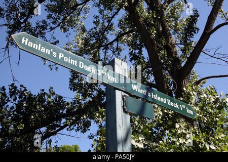 a signpost to Hanlan's Point Dock & Ward's Island Dock on Toronto Islands, Canada - Stock Photo