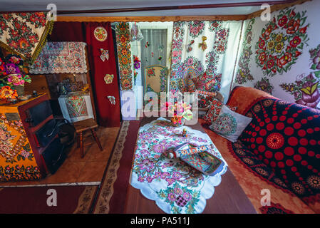 Interior of a cottage in Zalipie village in Poland, known for its local tradition of floral paintings made famous by folk artist Felicja Curylowa - Stock Photo