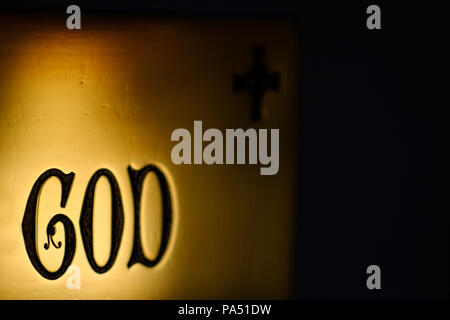 Gothic engraving of the word God on a brass plaque - Stock Photo