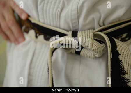 The Black Belts of Karate Masters - Stock Photo