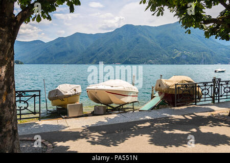 Boats moored at Lago di Lugano, Lake Lugano, Switzerland sailing boats marine concept, postcard picture perfect - Stock Photo