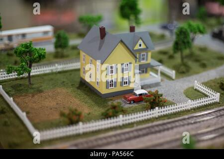 A miniature replica of a house with a 1950s car in front, at the Lane County Fair in Eugene, Oregon, USA. - Stock Photo