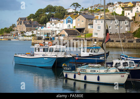 Colourful seaside homes and boats on the harbour in Brixham, Devon - Stock Photo