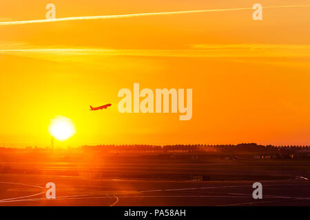 Silhouette of aeroplane, plane, take off on air at sunset time with all passenger on board for travel and for business at airport, with copy space - Stock Photo