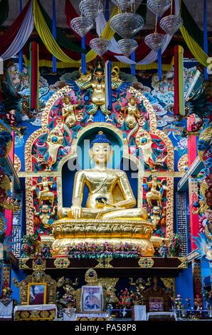 Golden statue of Buddha in Padmasambhava Buddhist Vihara in Namdroling Monastery in Mysore district, Karnataka, India - Stock Photo