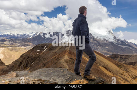 Hiker atop chacaltaya mountain in bolivia - Stock Photo