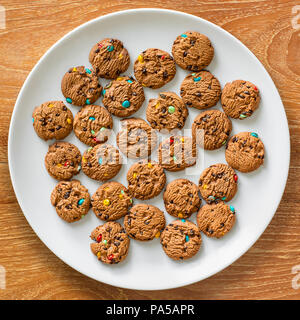 Lay flat photo of cookies on white plate. - Stock Photo