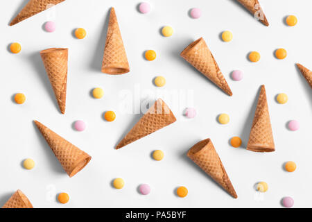 Ice cream cones and candy lay flat image wallpaper - Stock Photo