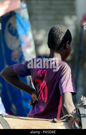 SAINT LOUIS, SENEGAL - APR 24, 2017: Unidentified Senegalese little boy puts his hand on a hip in Saint Louis, one of the major cities in Senegal - Stock Photo