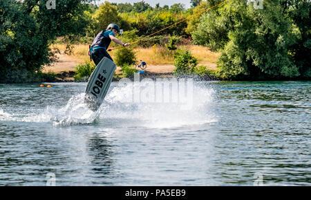 DUISBURG / GERMANY - JULY 18 2018 : Boy having fun with waterski on the lake - Stock Photo