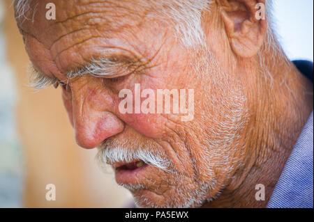 TASHKENT, UZBEKISTAN - JUNE 12, 2011: Portrait of an Uzbek old man on the street, Jun 12, 2011.  81% of people in Uzbekistan belong to Uzbek ethnic gr - Stock Photo