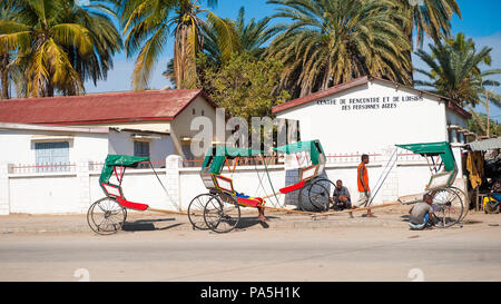 ANTANANARIVO, MADAGASCAR - JULY 3, 2011: Unidentified Madagascar people near the transporting carriages. People in Madagascar suffer of poverty due to - Stock Photo
