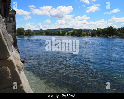 Landscapes of european STEIN am RHEIN town in SWITZERLAND and alpine Rhine River in swiss canton of Schaffhausen with medieval buildings, cloudy blue  - Stock Photo