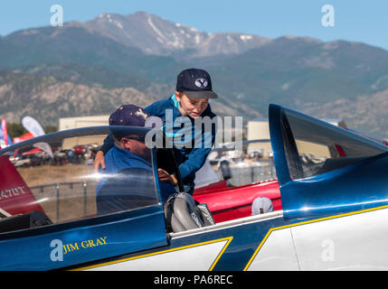 Father holding son to inspect Van's Aircraft RV-8; Harriett Alexander Field; air show; Salida; Colorado; USA - Stock Photo