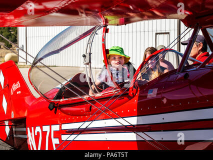 Young boy inspecting Pitts Special S2C biplane; Salida Fly-in & Air Show; Salida; Colorado; USA - Stock Photo