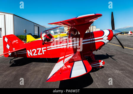 Pilot inspecting Pitts Special S2C biplane; Salida Fly-in & Air Show; Salida; Colorado; USA - Stock Photo