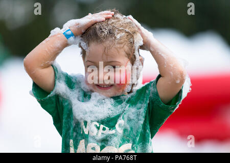 A young girl has messy fun at the NSPCC Messathon in Sandwell Valley Park, near Birmingham, UK. Peter Lopeman/Alamy Live News - Stock Photo
