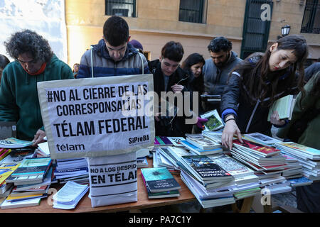 Writers, journalists, booksellers and workers of the Argentine State-Run News Agency (Télam) organised  today in front of the agency building a book swap in order to raise awareness on the conflict over the dismissal of 357 workers by Mauricio Macri's Administration. - Stock Photo