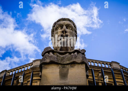 Scary stone head statue outside the Sheldonian Theatre in Oxford, Oxforshire, UK taken on 31 January 2018 - Stock Photo