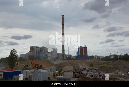 Construction of the factory,Construction site on the background of the factory. - Stock Photo