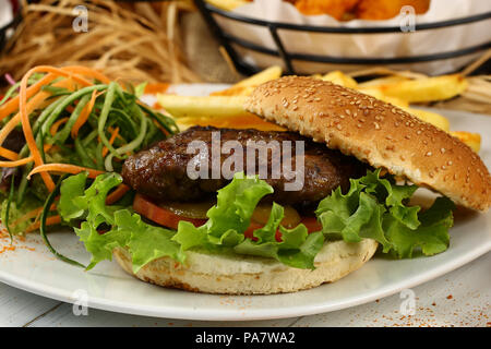 Tasty hamburger with french fries - Stock Photo
