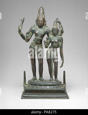 Shiva Embracing His Consort, Uma (Alinganamurti). Culture: India (Tamil Nadu). Dimensions: H. 15 in. (38.1 cm); W. 8 in. (20.3 cm); D. of base: 5 in. (12.7 cm). Date: late 11th century. Museum: Metropolitan Museum of Art, New York, USA. - Stock Photo