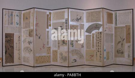Paintings and Calligraphy by Literati of Iga Ueno. Artist: Fifty-six artists. Culture: Japan. Dimensions: 55 in. x 12 ft. 4 1/2 in. (139.7 x 377.2 cm). Date: early 19th century.  This eight-panel screen demonstrates how small paintings in various formats, poem cards, and fans with brushed inscriptions could be preserved in premodern Japan. Instead of pasting them into an album or mounting them individually, a collector could attach to a screen tanzaku (vertical poem cards), shikishi (square poem cards), kaishi (larger horizontal poem sheets), fans, and larger paintings and calligraphic inscrip - Stock Photo