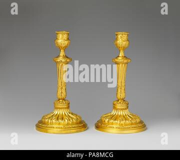 Pair of candlesticks. Culture: French. Dimensions: Overall (confirmed): 10 1/2 x 5 5/8 in. (26.7 x 14.3 cm). Date: ca. 1770-75. Museum: Metropolitan Museum of Art, New York, USA. - Stock Photo