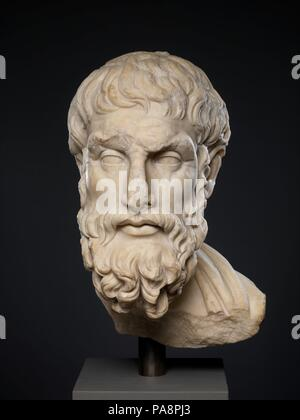 Marble head of Epikouros. Culture: Roman. Dimensions: 19 5/8 × 9 3/4 × 11 1/2 in. (49.8 × 24.8 × 29.2 cm). Date: 2nd century A.D..  Copy of a Greek statue of the 1st half of the 3rd century B.C.  The philosopher, who lived from 341 to 271 B.C., must have been honored by a portrait statue made late in his lifetime or soon after his death. Numerous Roman copies reproduce the same original, showing the esteem in which Epicurus' teachings were held. Museum: Metropolitan Museum of Art, New York, USA. - Stock Photo