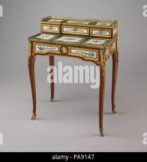 Small writing desk (bonheur-du-jour). Culture: French, Paris and Sèvres. Decorator: Jean-Jacques Pierre the Younger (French, active 1763-1800). Dimensions: Overall: 32 1/2 × 25 7/8 × 16 in. (82.6 × 65.7 × 40.6 cm). Factory: Porcelain plaques by Sèvres Manufactory (French, 1740-present). Maker: Martin Carlin (French, near Freiburg im Breisgau ca. 1730-1785 Paris). Date: ca. 1774.  The 1795 inventory of furniture belonging to Louis XVI's sister-in-law, Marie-Thérèse of Savoy, comtesse d'Artois (1756-1805), gives a description of a similar desk, or bonheur du jour, which may refer to this piece.  - Stock Photo