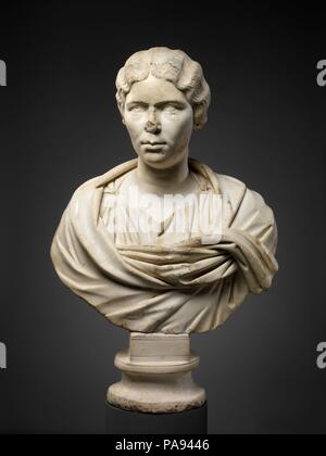 Marble portrait bust of a woman. Culture: Roman. Dimensions: 29 3/4 in. × 19 1/2 in. × 10 in. (75.6 × 49.5 × 25.4 cm). Date: ca. A.D. 155-165.  This woman wears a stola and palla wrapped around her shoulders. A separate marble piece in the form of a bun was originally attached at the back of the head. The arrangement of the hair is like that worn by Faustina the Younger, wife of Marcus Aurelius, around the middle of the second century A.D. Museum: Metropolitan Museum of Art, New York, USA. - Stock Photo