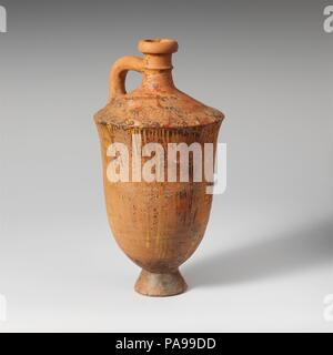 Terracotta lekythos (oil flask). Culture: Lydian. Dimensions: 8 1/8in. (20.6cm). Date: late 7th-6th century B.C..  The decoration is a kind of marblizing that was favored for various, particularly local, shapes at Sardis. Museum: Metropolitan Museum of Art, New York, USA. - Stock Photo