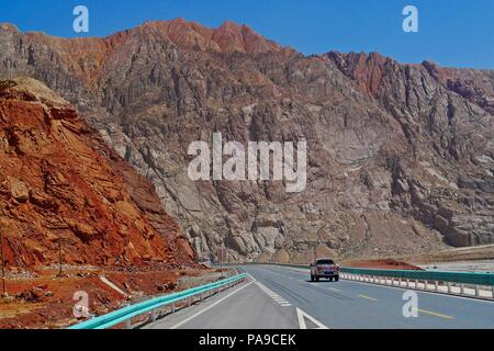 The good paved road conditions and beautiful scenic view of Karakoram Highway (China Section) in Xinjiang. - Stock Photo